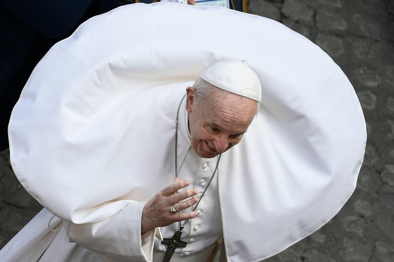 Pope Francis with his white cape billowing in a perfect circle around his head and shoulders