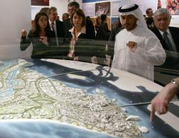 French Culture Minister Christine Albanel (C) and Sheikh Sultan bin Tahnun al-Nahayan (2nd R), president of Abu Dhabi tourism authority, look at the location of the Louvre museum on a map of Saadiyat Island in the Emirati capital of Abu Dhabi. Click image to expand.