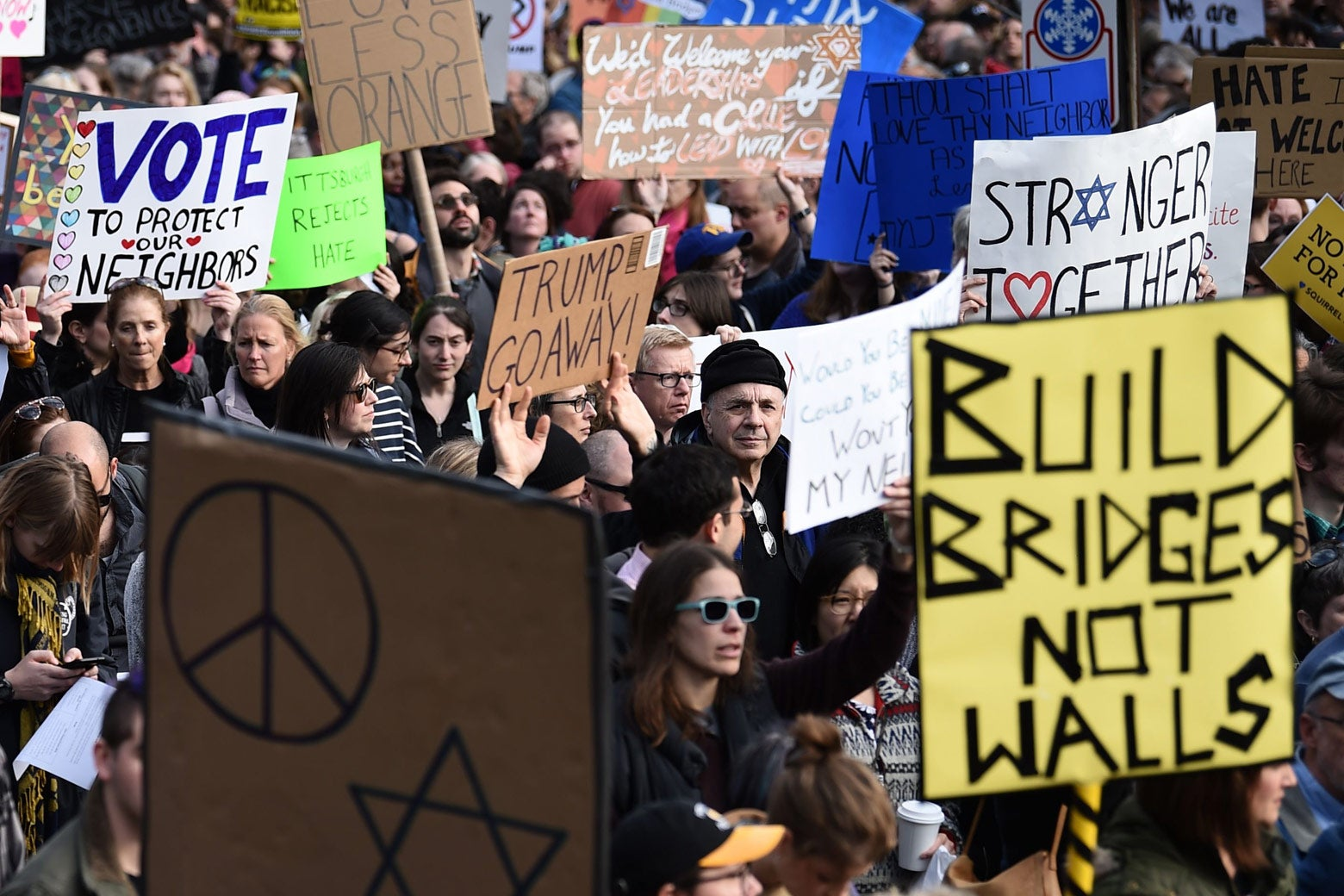 People protest the arrival of President Donald Trump as he visits the Tree of Life Congregation on Oct. 30 in Pittsburgh.