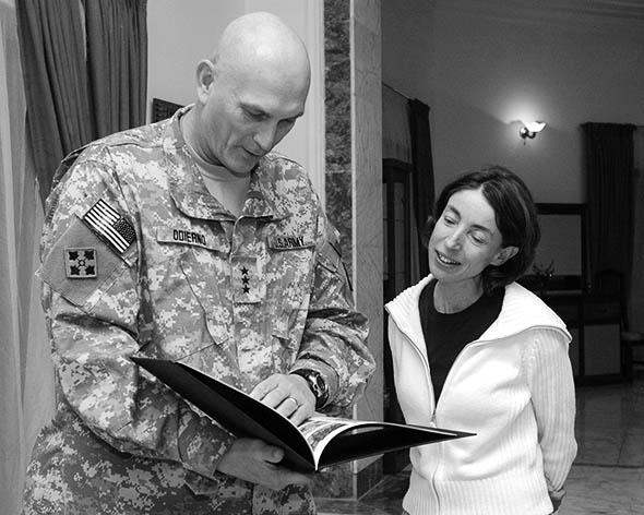 Lieutenant General Odierno presenting Sky with photo album of her time as his political adviser in Iraq.
