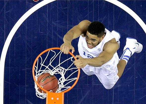 Kentucky Wildcat Karl-Anthony Towns dunks the ball against the Arkansas Razorbacks in the championship game of the SEC championship game in Nashville, Tennessee, on March 15, 2015.