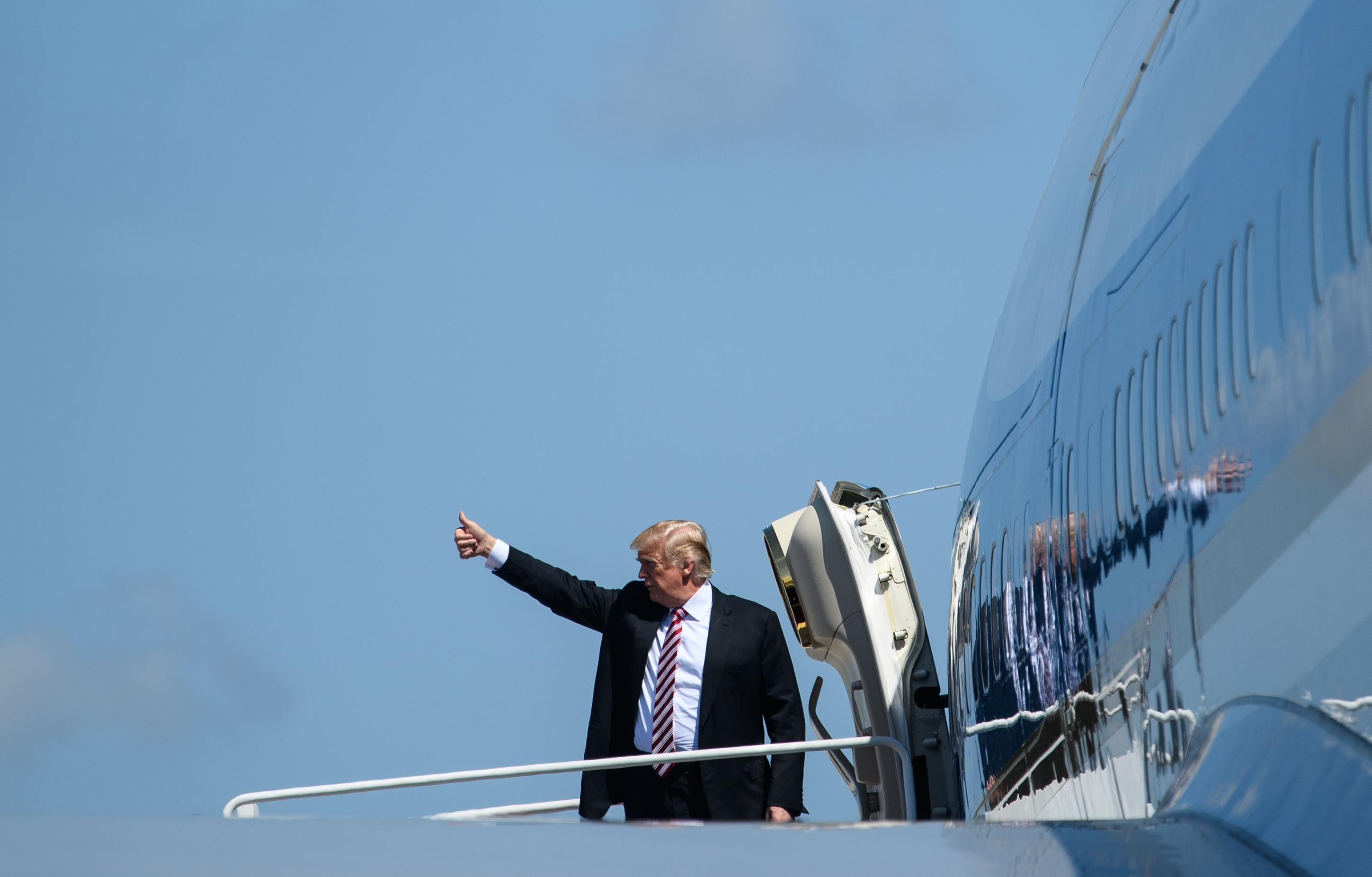 Donald Trump gives a thumbs up before boarding Air Force One.