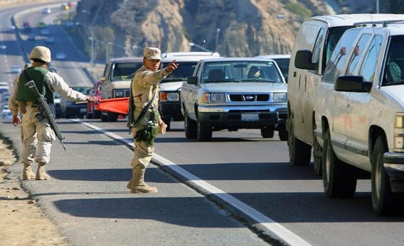 Soldiers of the Mexican Army stop vehicles as part of a security operation at a checkpoint in Tijuana, in the border state of Baja California, Mexico, 06 January 2007.