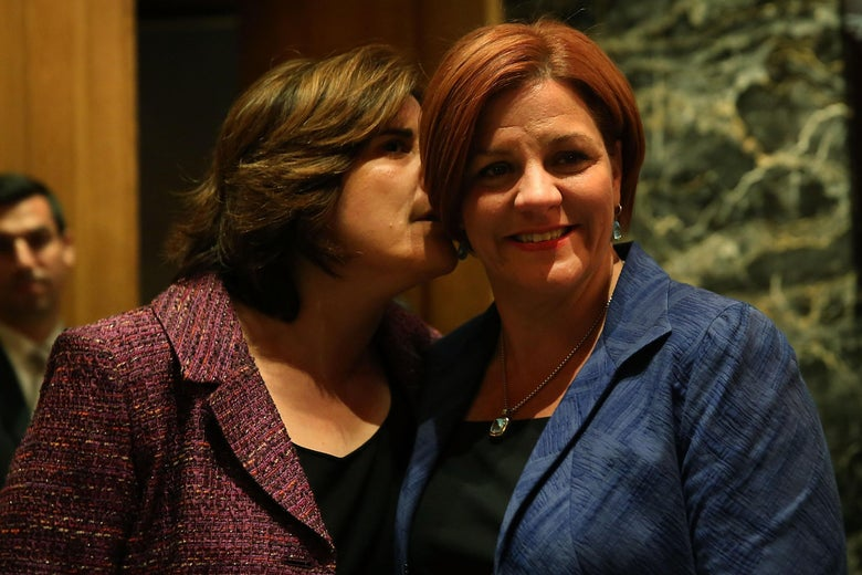 NEW YORK, NY - SEPTEMBER 10: New York City Council Speaker Christine Quinn (R) stands backstage with her wife Kim Catullo moments before conceding defeat in the New York Democratic mayoral primary elections on September 10, 2013 in New York City. Quinn, who lead early in the polls and who was endorsed by all of New York's major newspapers, saw her lead slip away in the final weeks of the campaign. Quinn would have been the first woman and lesbian to hold the job of mayor. (Photo by Spencer Platt/Getty Images)