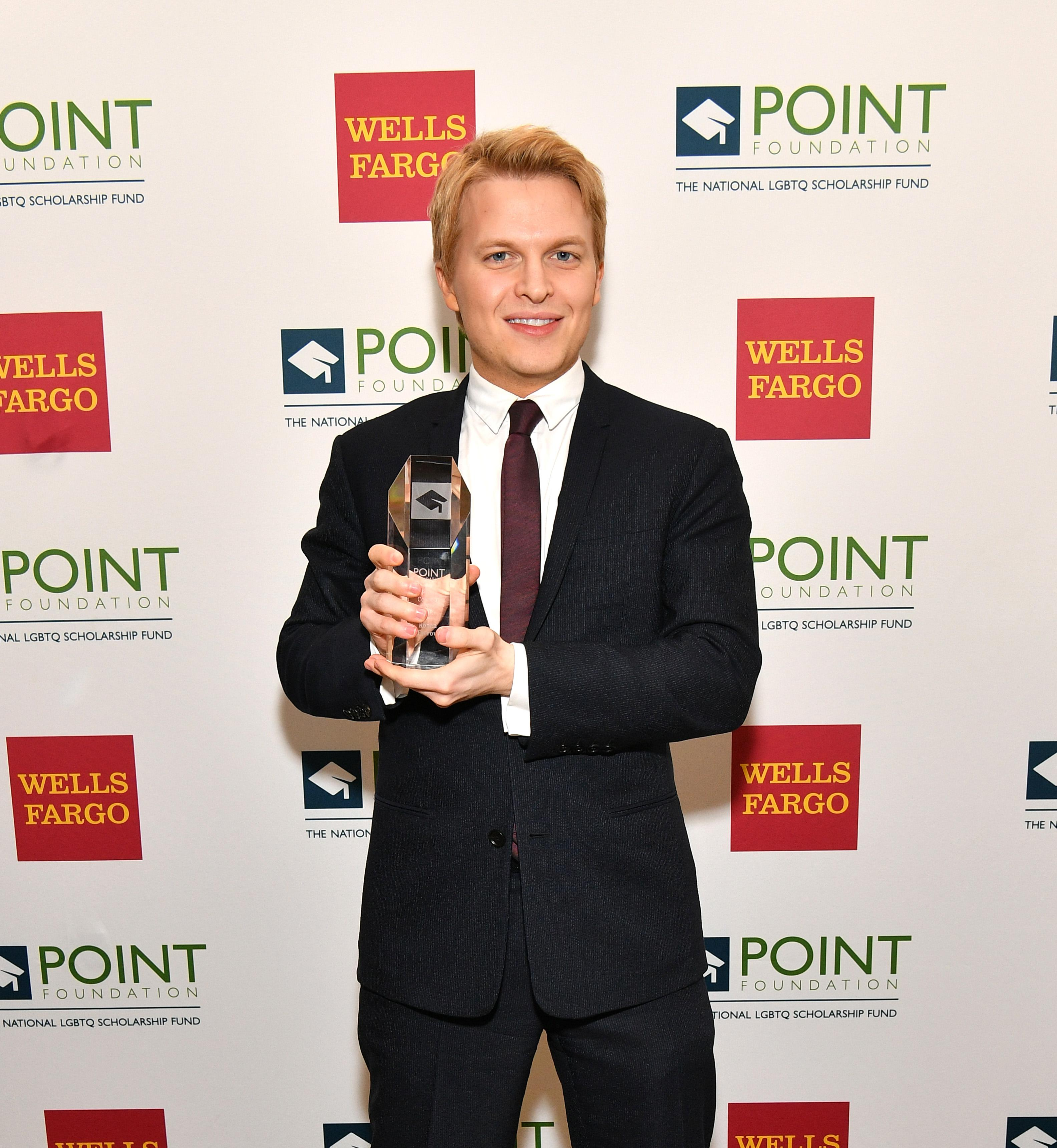 Ronan Farrow poses with an award at The Plaza Hotel on April 9, 2018 in New York City.