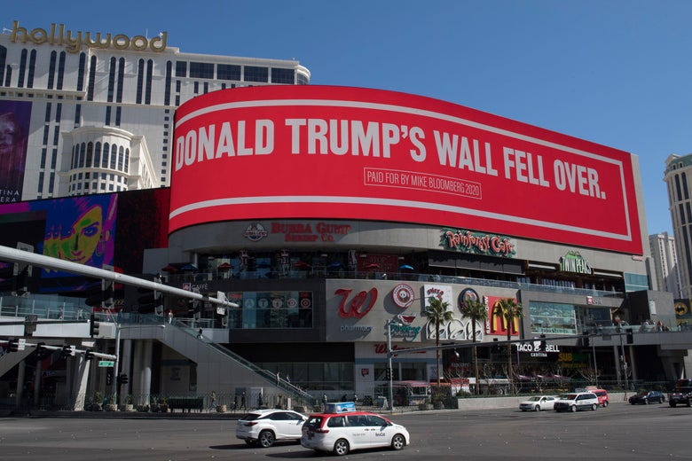 A third billboard paid for Bloomberg says Trump's wall fell over.