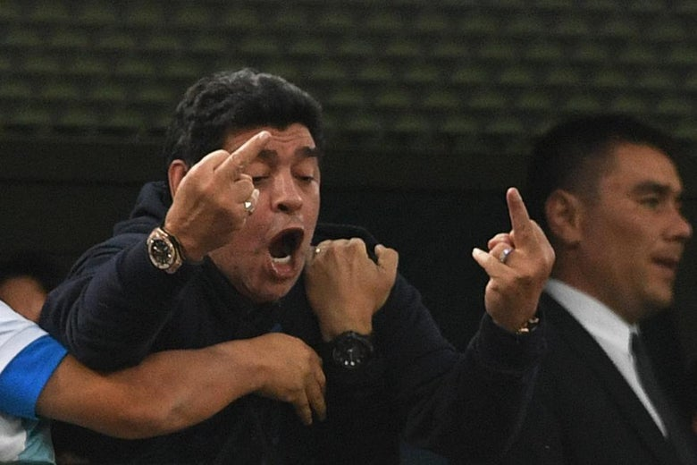 Retired Argentina player Diego Maradona gestures during the Russia 2018 World Cup Group D football match between Nigeria and Argentina at the Saint Petersburg Stadium in Saint Petersburg on June 26, 2018. (Photo by OLGA MALTSEVA / AFP) / RESTRICTED TO EDITORIAL USE - NO MOBILE PUSH ALERTS/DOWNLOADS        (Photo credit should read OLGA MALTSEVA/AFP/Getty Images)