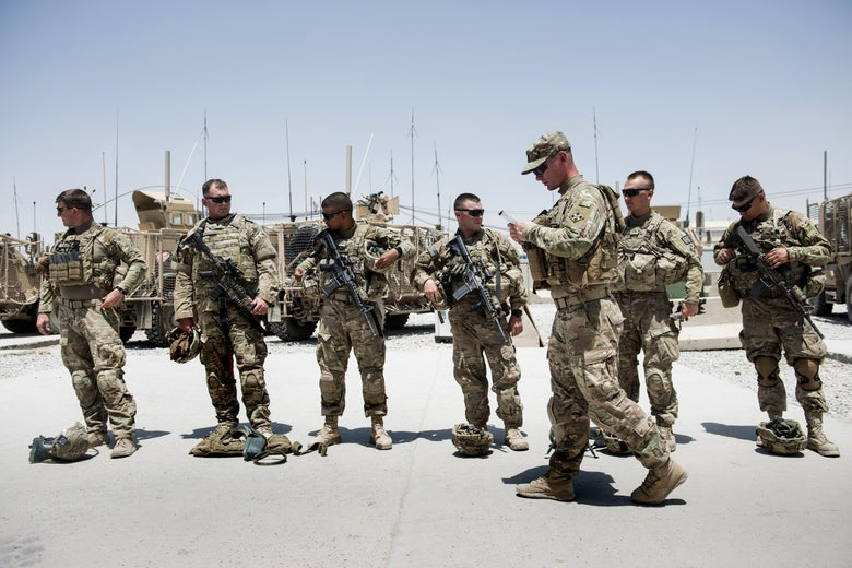 Members of the U.S. Army's 4th Infantry Division prepare for patrol at Kandahar Airfield, Afghanistan, in June 2014.