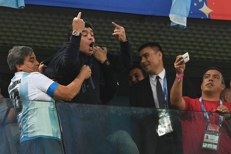 TOPSHOT - Retired Argentina player Diego Maradona (C) gestures during the Russia 2018 World Cup Group D football match between Nigeria and Argentina at the Saint Petersburg Stadium in Saint Petersburg on June 26, 2018. (Photo by OLGA MALTSEVA / AFP) / RESTRICTED TO EDITORIAL USE - NO MOBILE PUSH ALERTS/DOWNLOADS        (Photo credit should read OLGA MALTSEVA/AFP/Getty Images)