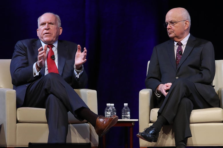 John Brennan and Michael Hayden seated in armchairs onstage.