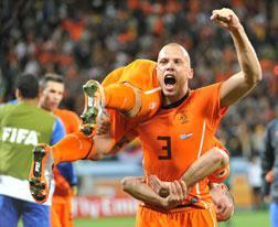 Netherlands' defender John Heitinga carries Netherlands' striker Arjen Robben. Click image to expand.