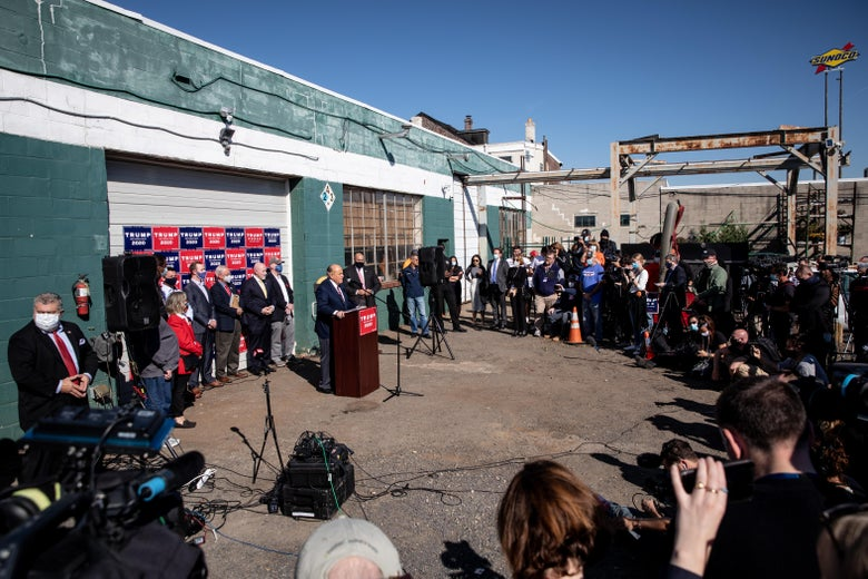 Rudy Giuliani speaks to the media at a press conference held in the back parking lot of landscaping company on November 7, 2020 in Philadelphia, Pennsylvania.