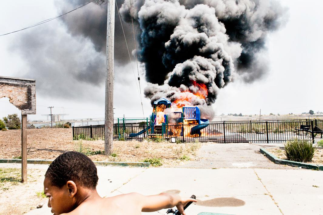A child watches as the playground at the Alice Griffith public housing development burns to the ground after being set on fire by an unknown culprit.  Alice Griffith's long-awaited redevelopment is slated to begin this year.Children gather as the playground at the Alice Griffith public housing development burns to the ground after being set on fire by an unknown culprit.  Alice Griffith's long-awaited redevelopment is slated to begin this year.