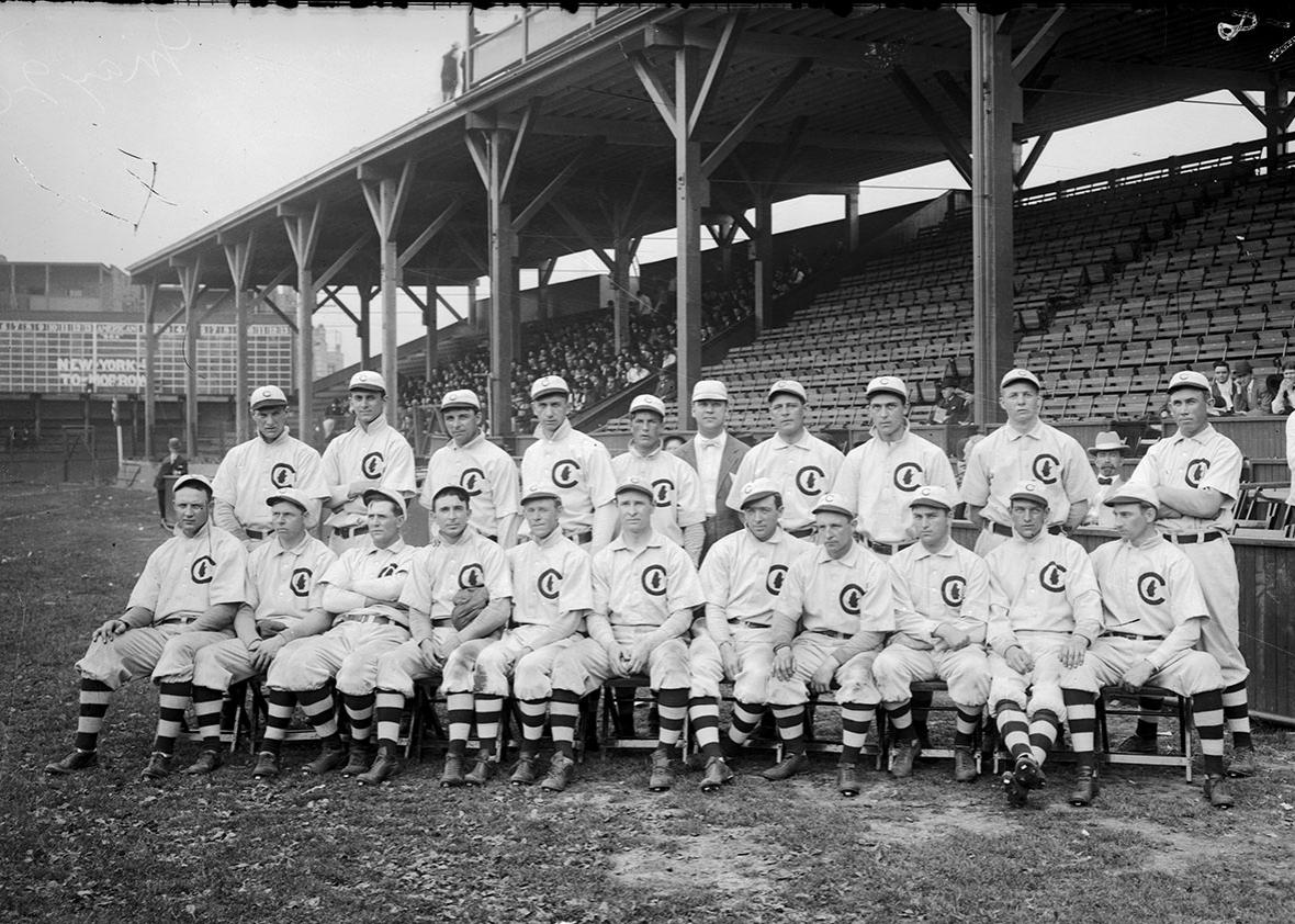 Group portrait of National League's Chicago Cubs baseball team players, World Champions 1908, posing for a photograph on the field at West Side Grounds, Chicago, Illinois, 1908.