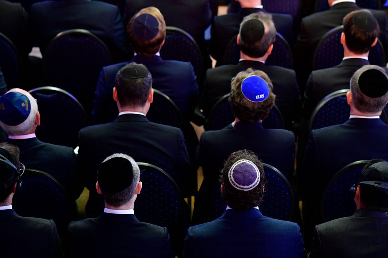 Men wearing kippah skullcaps attend an ordination ceremony at the Bet Zion synagogue in Berlin on October 8, 2018.