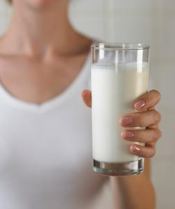 Woman holding a glass of milk. Click image to expand.