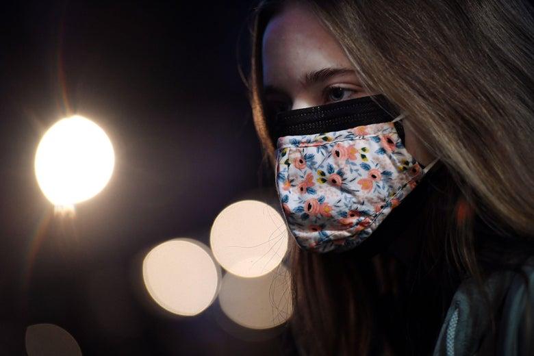A woman wearing two masks.