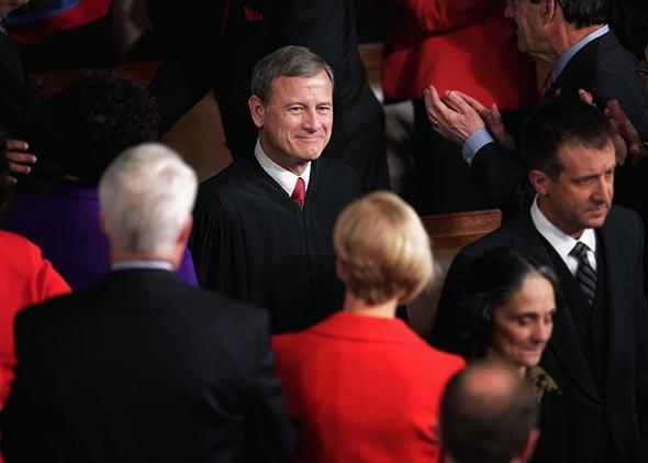 Supreme Court Chief Justice John Roberts arrives in the House Chamber before U.S. President Barack Obama delivers the State of the Union address to a joint session of Congress at the U.S. Capitol on January 28, 2014 in Washington, DC.