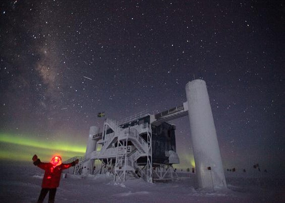 A scientist enjoys the winter cold and darkness outside the Ice Cube Laboratory at Amundsen-Scott South Pole Station, on August 17, 2012.
