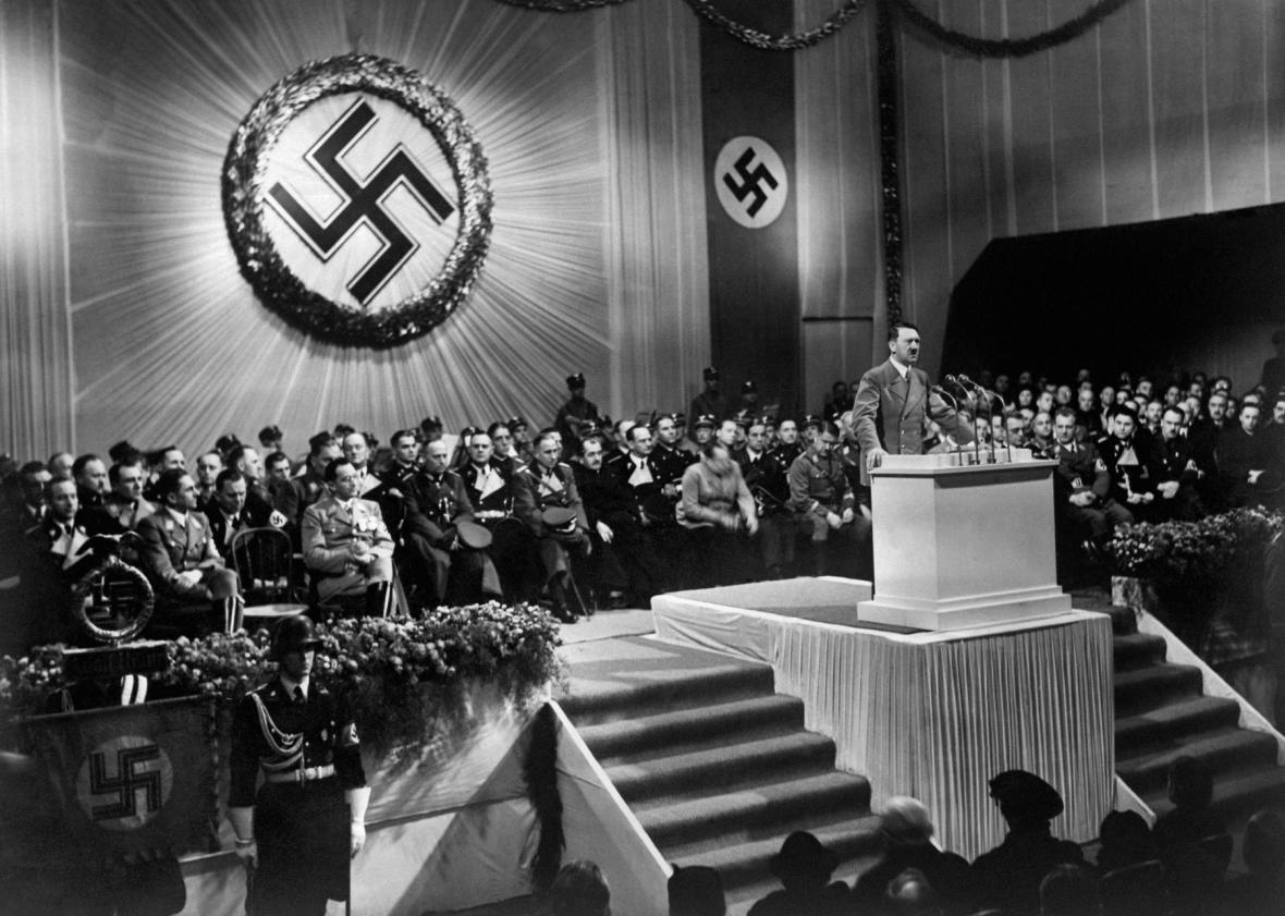 ARP2347398A picture dated 1939 shows German nazi Chancellor and dictator Adolf Hitler giving a speech during a meeting with nazi high rank officials seated under a large swastika.