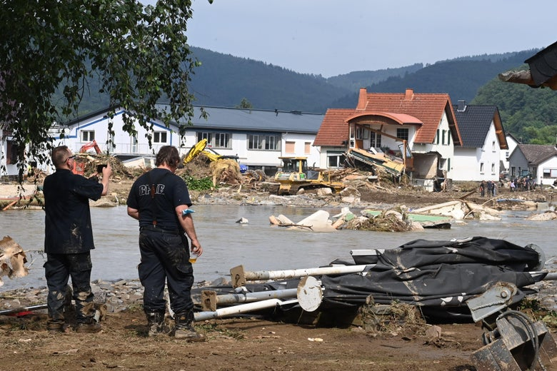 A worker takes a picture of a destroyed area in Insul near Bad Neuenahr-Ahrweiler, western Germany, on July 17, 2021.
