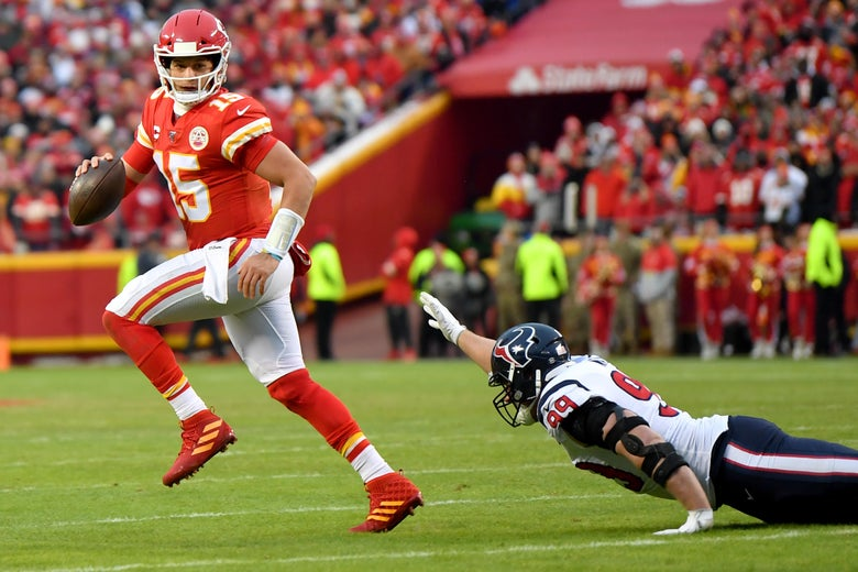 Watt, lying on the field, raises his torso and reaches for Mahomes with one arm as Mahomes runs off with the football.