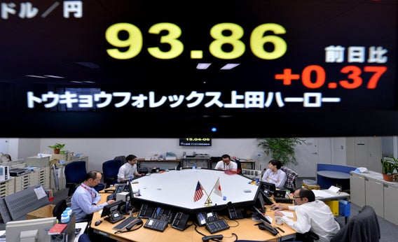 An electronic board flashes the numbers of the foreign exchange rate of the yen against $1 U.S. (top) at a foreign exchange brokerage in Tokyo on Feb. 6, 2013.