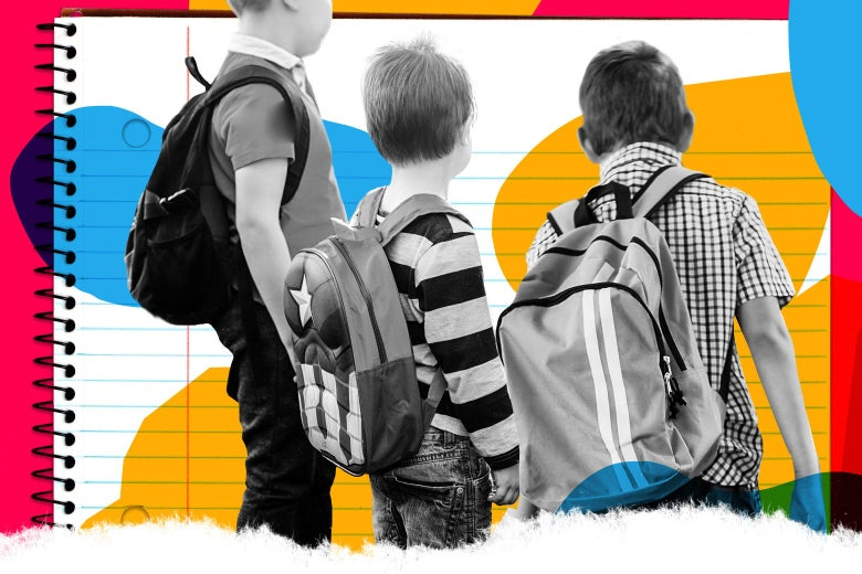 Three young boys stand together with their backpacks on.