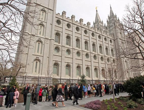 Mormon faithful line up outside the historic Salt Lake Temple.