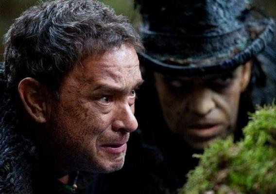 Zachry (Tom Hanks) and the demon Old Georgie (Hugo Weaving) in Cloud Atlas.