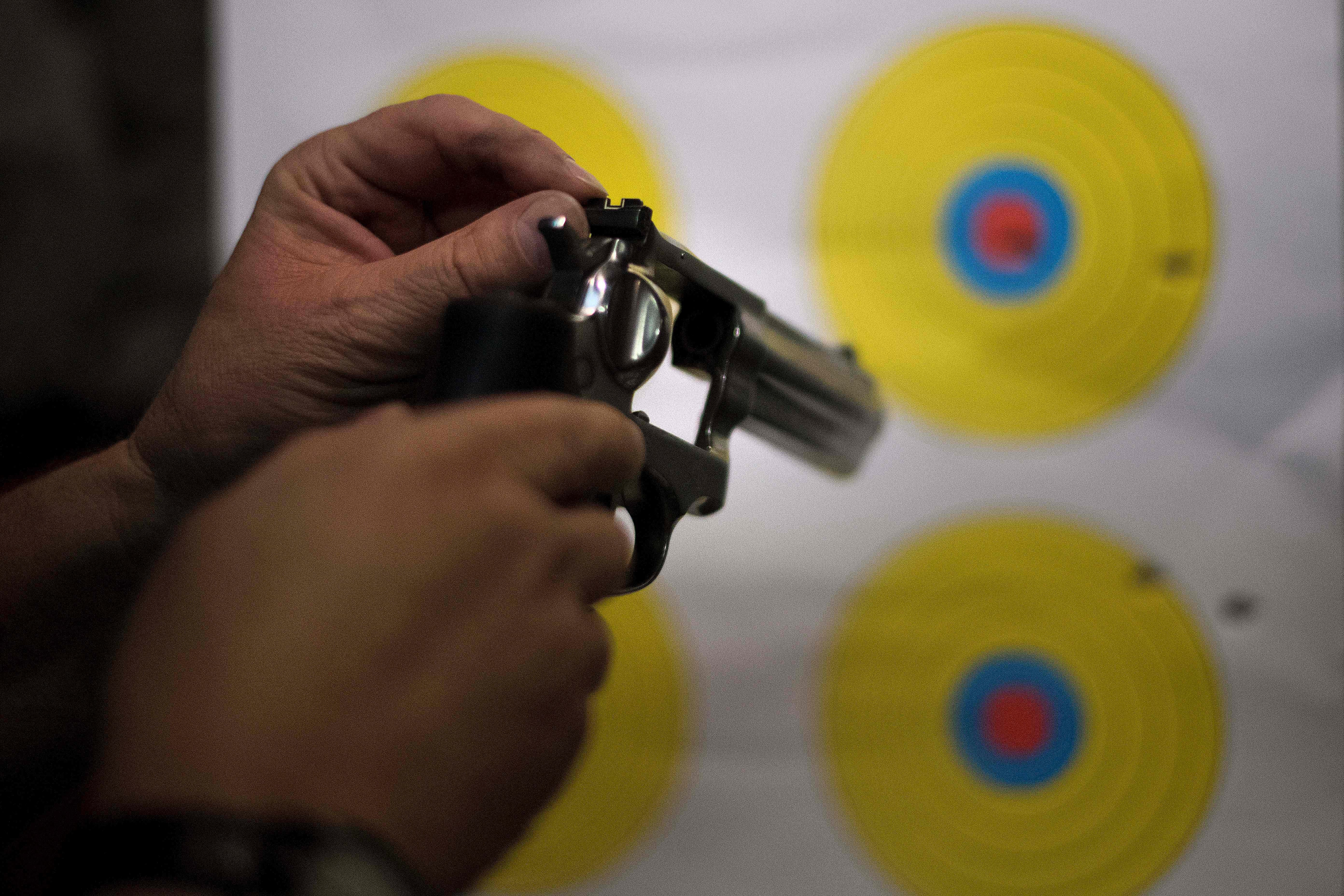 A man adjusts the sights on his .357 revolver at the Lynchburg Arms & Indoor Shooting Range in Lynchburg, Virginia, on October 20, 2017.         Virginia residents go to the polls on November 7 to vote for governor and members of the state's legislature. Following a mass shooting in Las Vegas that killed 58 people and wounded nearly 500 earlier this month, gun control has become a key issue in the state's 2017 elections. The NRA has spent more than $750,000 in support of Republican gubernatorial candidate Ed Gillespie, whom the organization awarded an 'A' rating 'for his strong support of the Second Amendment' to the US Constitution, which guarantees the right to bear arms.          / AFP PHOTO / JIM WATSON        (Photo credit should read JIM WATSON/AFP/Getty Images)