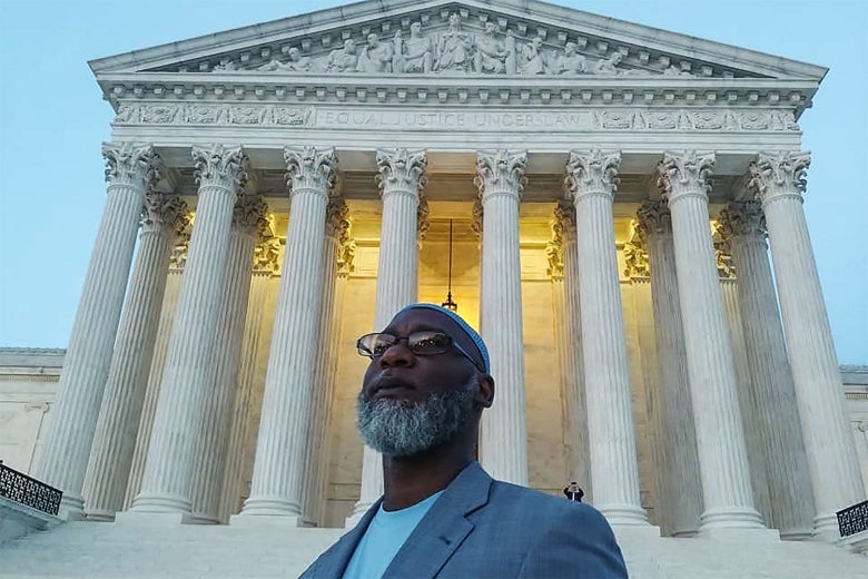 Abd'Allah Lateef stands in front of the Supreme Court.