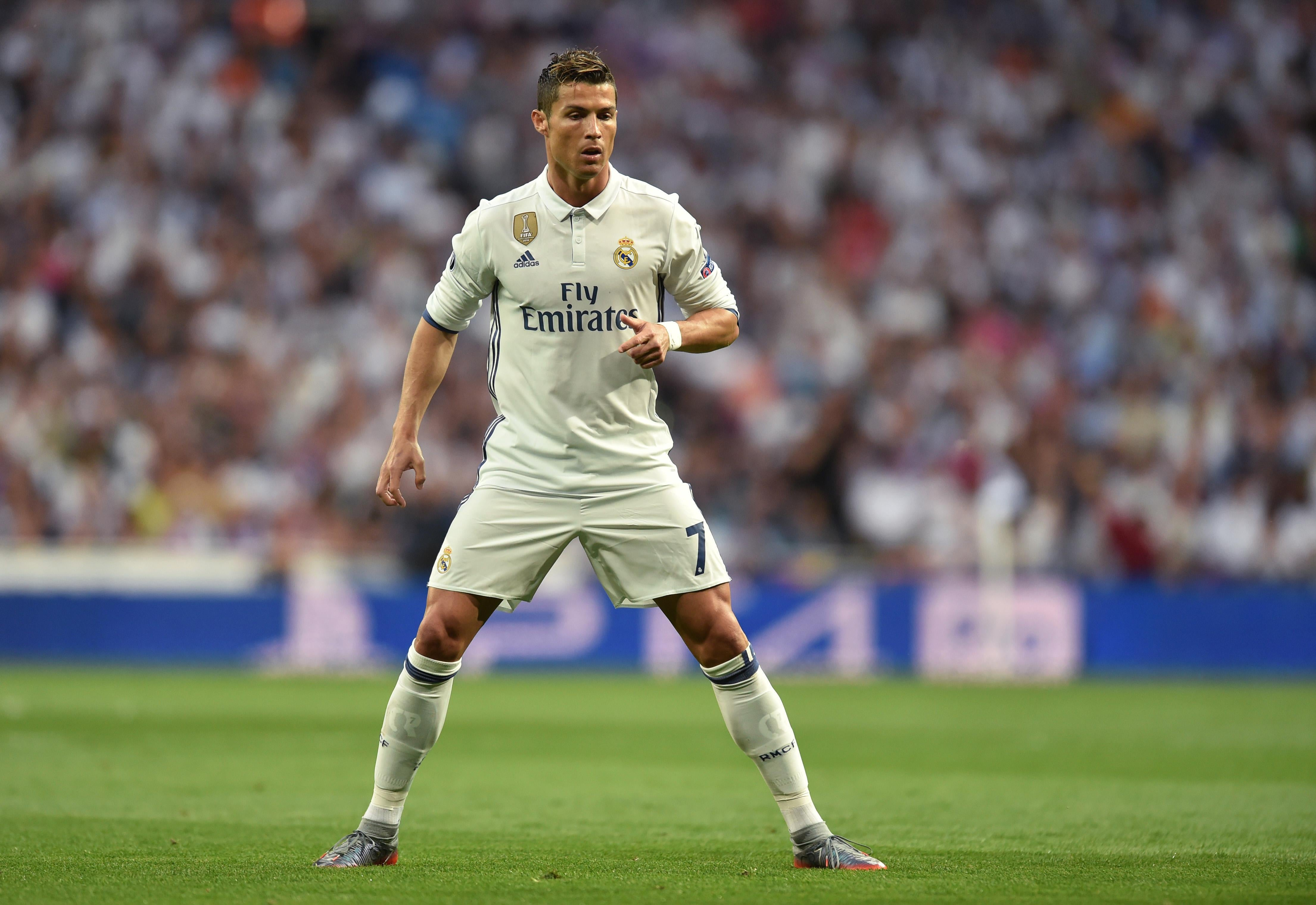 Real Madrid's Portuguese forward Cristiano Ronaldo prepares for a free kick.