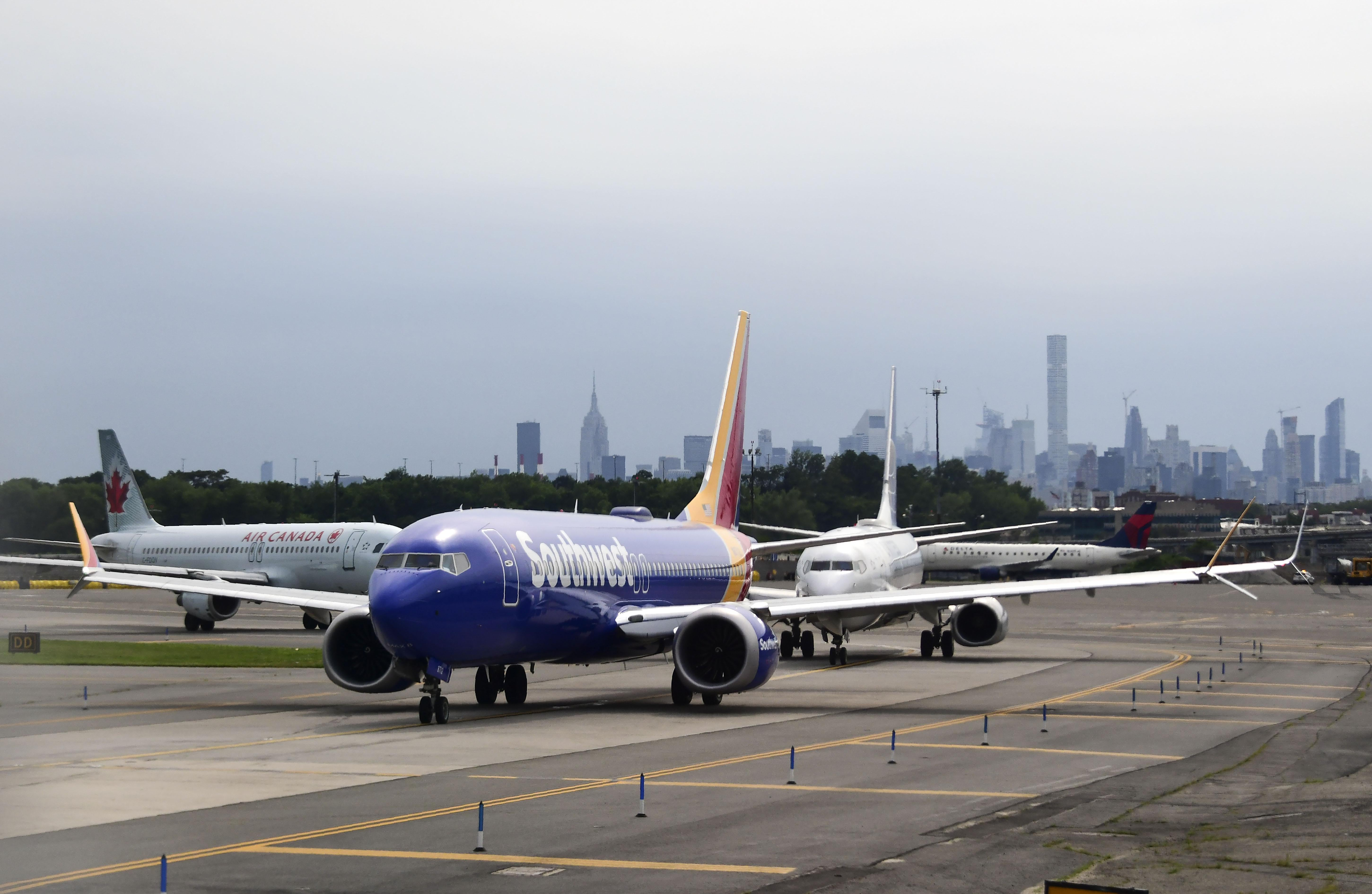 A Southwest Airlines plane lines up with other aircraft on the tarmac