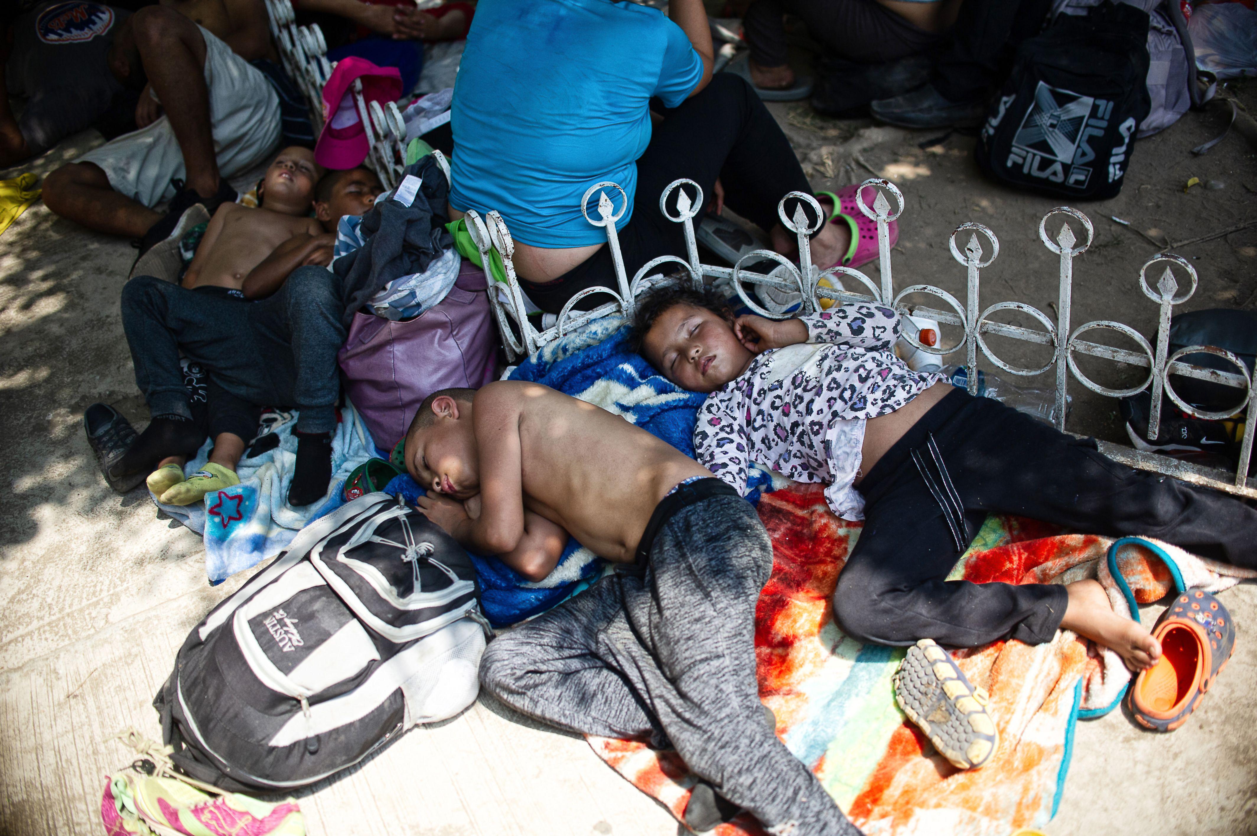 Central American migrant children en route to the U.S. border rest near Huehuetan, Chiapas state, Mexico, on April 15, 2019.
