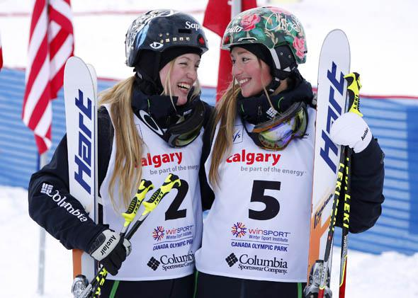 First place finisher Justine Dufour-Lapointe (L) and sister Chloe Dufour-Lapointe, third place,  smile at each other during the women's moguls finals at the FIS Freestyle Ski World Cup January 4, 2014 in Calgary, Alberta, Canada.
