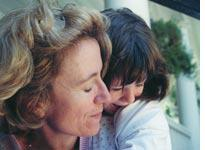 Marjorie with daughter Alice, shortly after her diagnosis, summer 2001. Click image to expand.