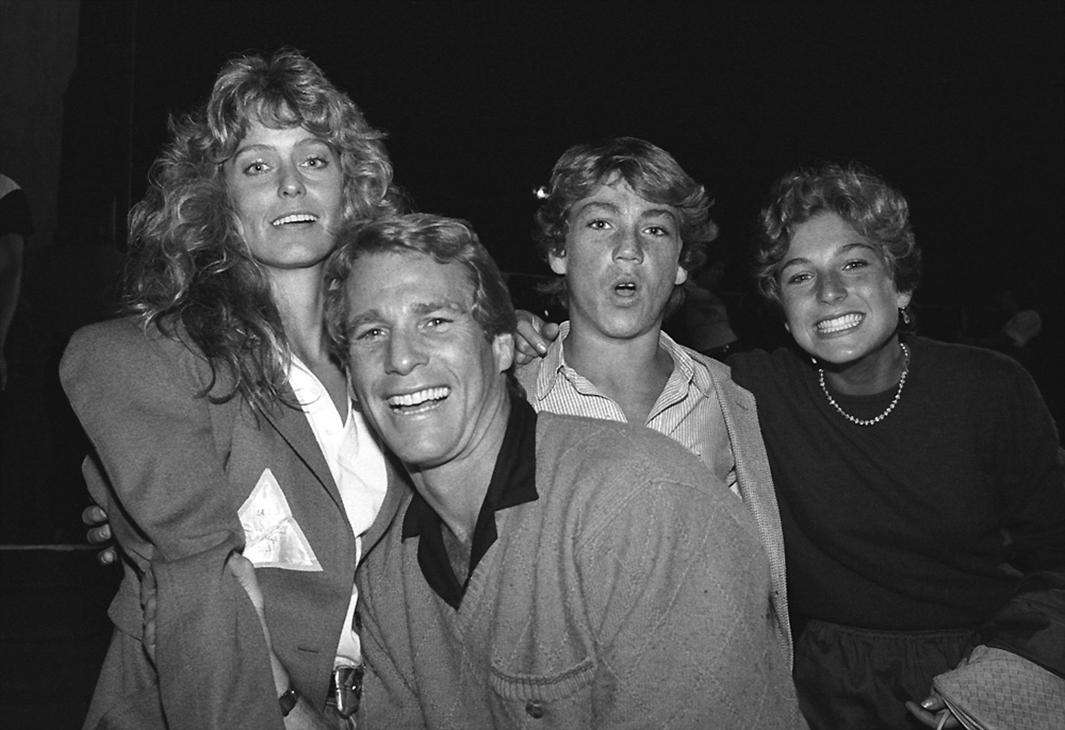 "I was hanging out backstage at a Rolling Stones concert when I s,I was hanging out backstage at a Rolling Stones concert when I spotted Farrah Fawcett with Ryan O' Neal. The rumor going around, at that time, was that they were dating. Farrah, Ryan and his kids, Tatum and Griffin were on their way to their seats in the VIP section, just off the side of the stage. I approached Ryan and asked for the photo. He totally blew me off and just kept walking past me. Suddenly he turned around and said to me ""No one ever asks me if they can take my photo. Since you were kind enough to ask, go for it, but just one photo,"" Ryan said. I sold this photo (his kids Tatum and Griffin are also in the shot) over and over again. It made about $5,000 - a fortune for a B/W photo back then."