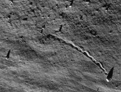 rolling boulder on the Moon
