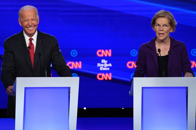 Elizabeth Warren speaks as Joe Biden gestures.