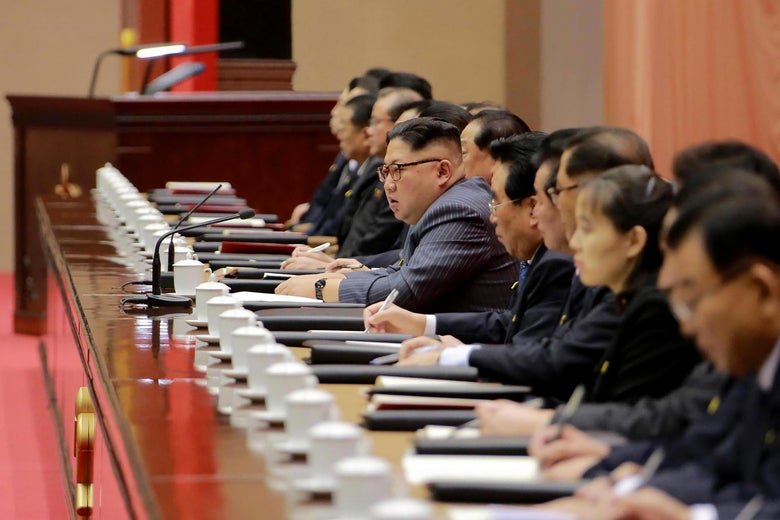 This picture taken on December 22, 2017 and released from North Korea's official Korean Central News Agency (KCNA) on December 23, 2017 shows North Korean leader Kim Jong-Un (C) speaking during the second day of the 5th Conference of Cell Chairpersons of the Workers' Party of Korea (WPK) in Pyongyang.