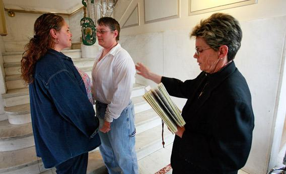 Amy Klein-Matheny (L) and her wife Jennifer are married by Rev. Peg Esperanza (R) near a stairway in the Polk County Administration Building April 27, 2009 in Des Moines, Iowa.