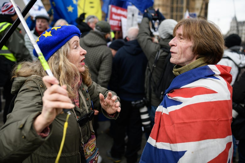 Pro-EU and pro-Brexit protesters discuss the vote and ongoing political processes as they demonstrate near to the Houses of Parliament on Tuesday in London.