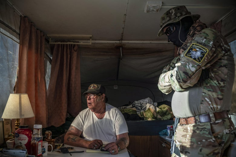 Right-wing militia group holds migrants at gunpoint near the border.