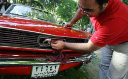 An Iranian man cleans his Ford Mustang. Click image to expand.