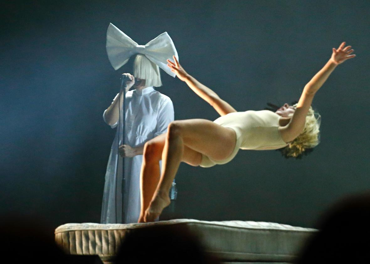 Sia performs with one of her avatars at the Panorama Music Festival in July.