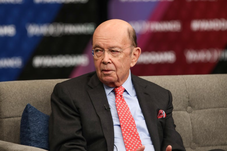 Wilbur Ross sits on a couch at a financial event.