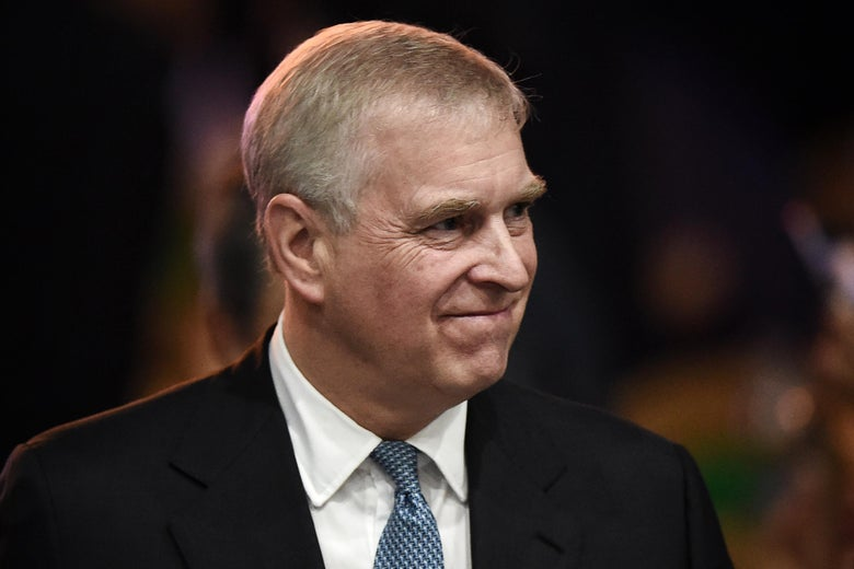 Prince Andrew offers a closed-mouth smile.