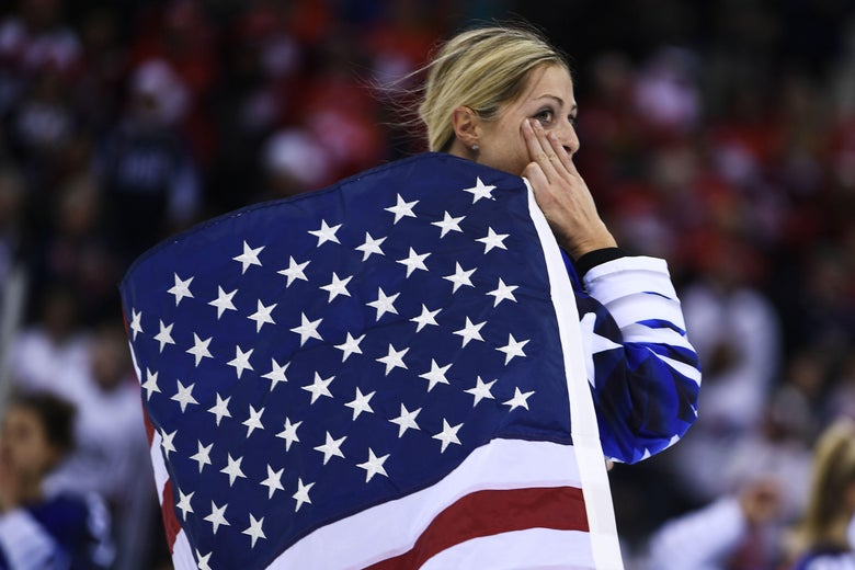USA's Gigi Marvin holds the US flag after her team won the women's gold medal ice hockey match between the US and Canada during the Pyeongchang 2018 Winter Olympic Games at the Gangneung Hockey Centre in Gangneung on February 22, 2018.   / AFP PHOTO / Brendan Smialowski        (Photo credit should read BRENDAN SMIALOWSKI/AFP/Getty Images)
