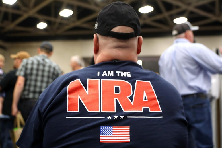 An man wears an NRA shirt on May 5 in Dallas.